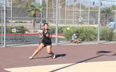 Captain Isabella Angon getting ready to hit a tennis ball to the other side of the court in a match against Montclair. Isabella says, Its just something about sports that I really love.